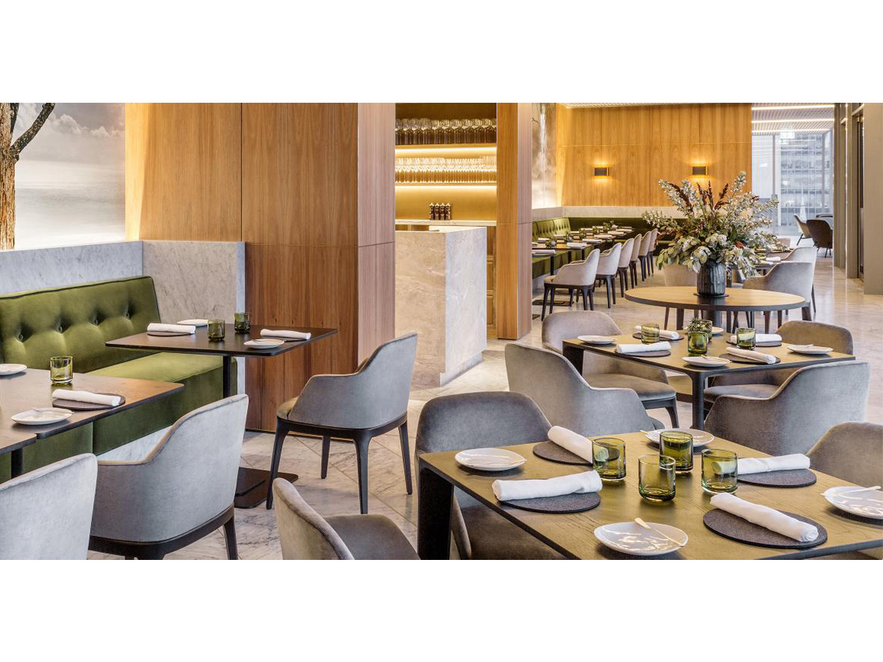 Function room set for dining with individual square tables and grey seats
