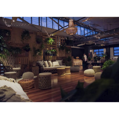 Large lounge room set for evening function with lounges and decorative hanging plants