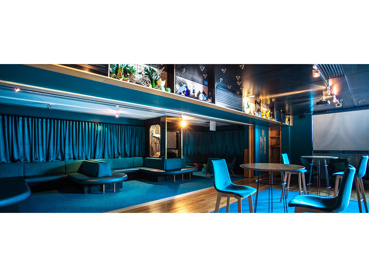 Function room with stylish blue decor with matching blue chairs and tables