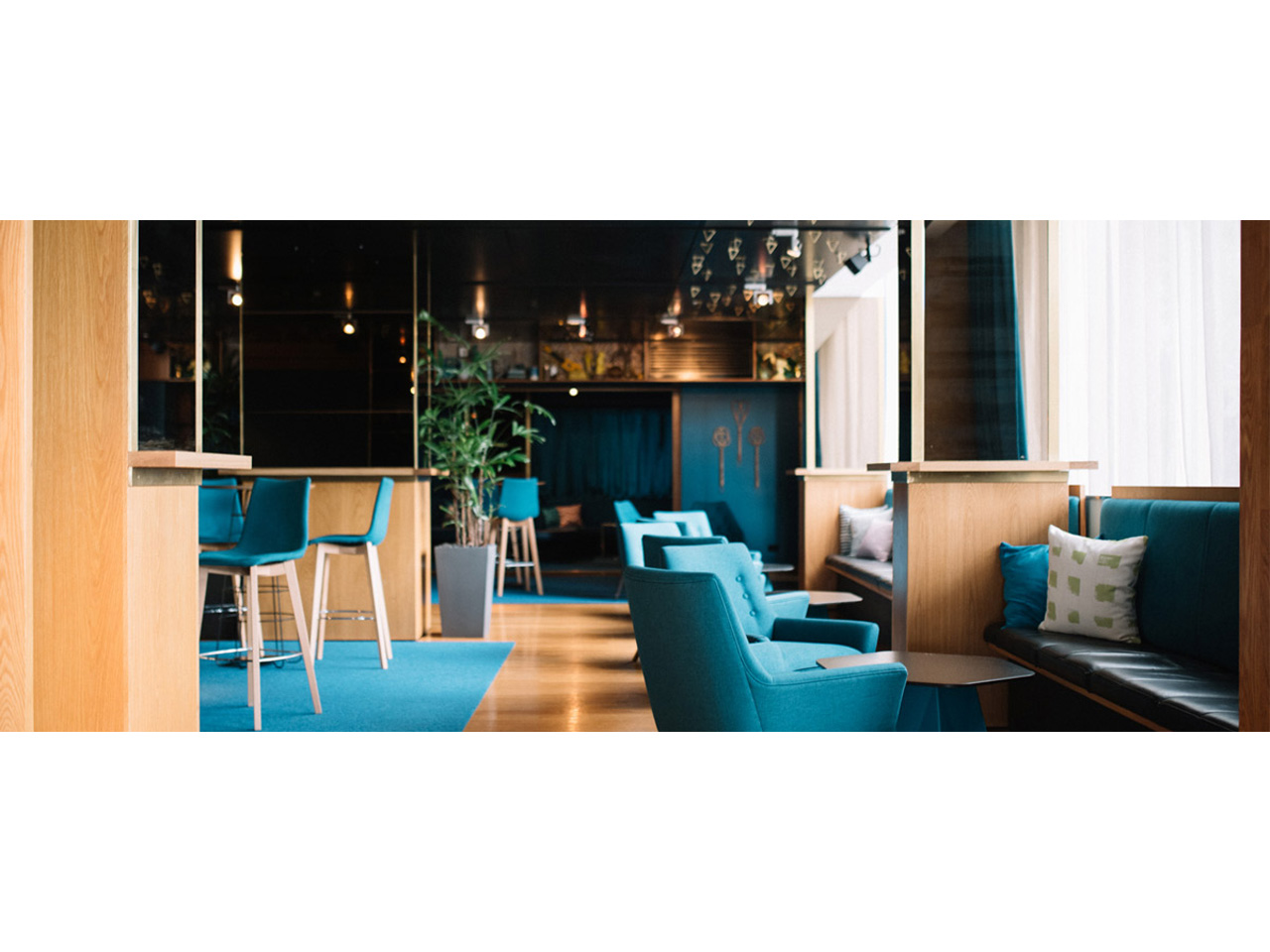 Function room with stylish blue and wood decor with matching blue chairs and wooden floor