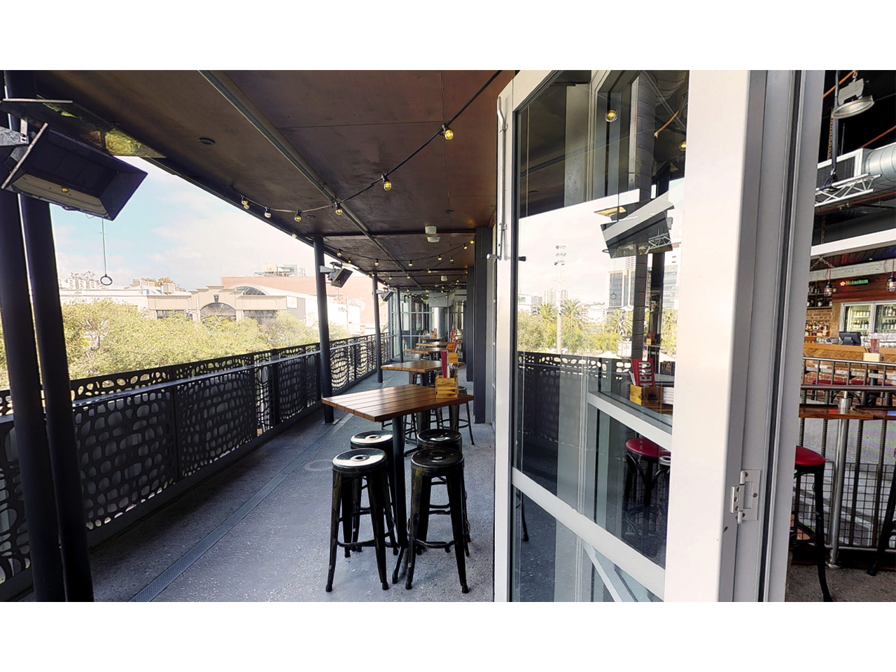 Balcony with chairs and tables overlooking Northbridge