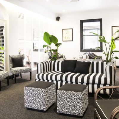 Black and white striped lounger with foot rest in bar area