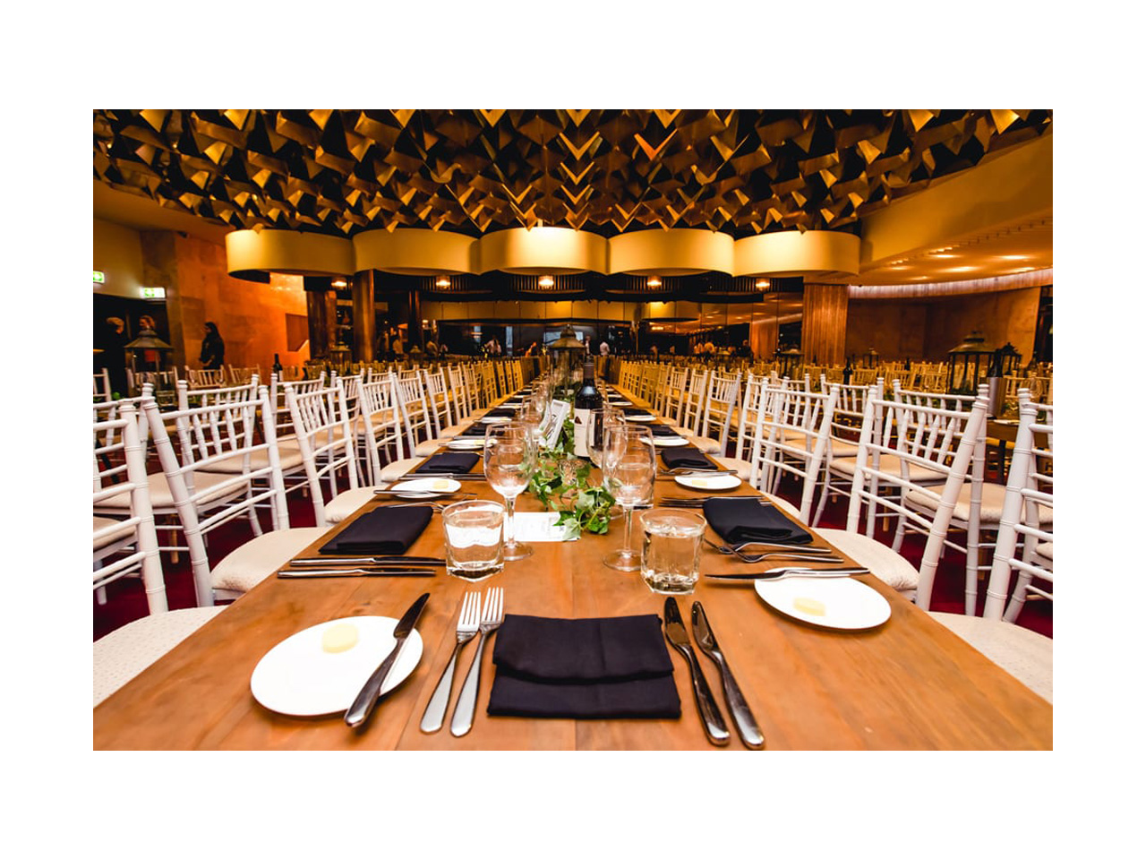 Large function room with long table with exquisite decor