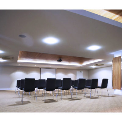 Inside The Function Room With Chairs, Projector And A Projection Screen