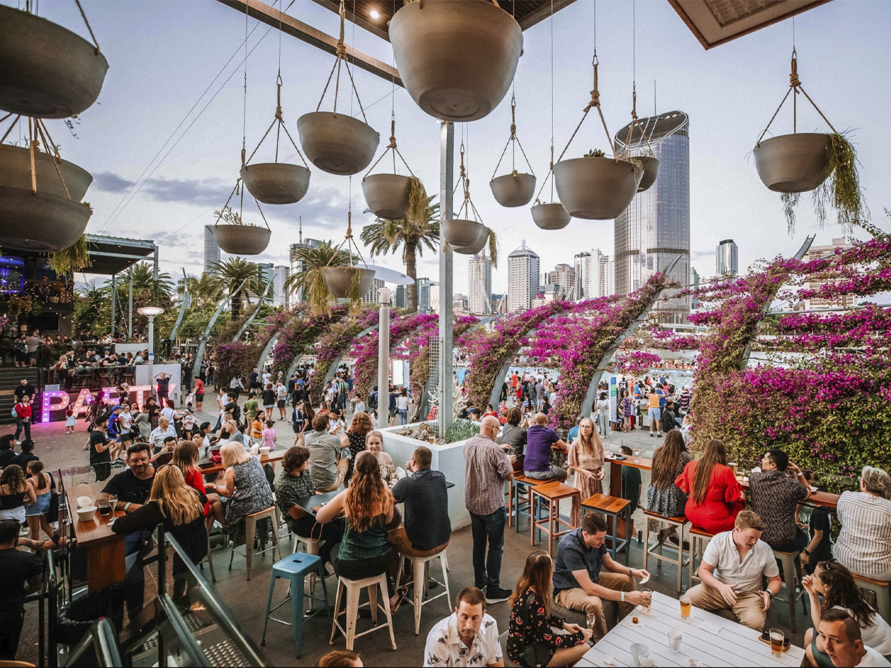 The Lookout venue with hanging pots and crowd overlooking city