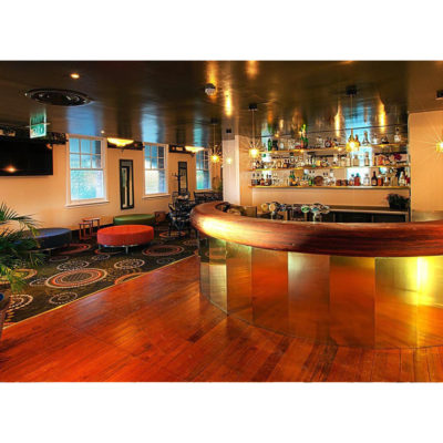 Large function room with circular bar and tables