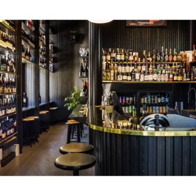Black liquor bar filled with alcohol bottles