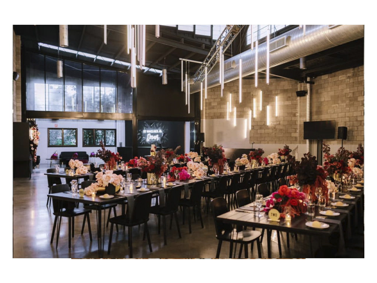 Unique Brisbane wedding venue with long tables decorated for function