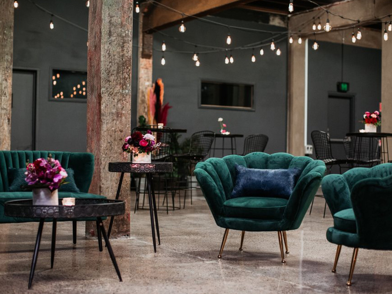 Inspiring event space with green chairs
