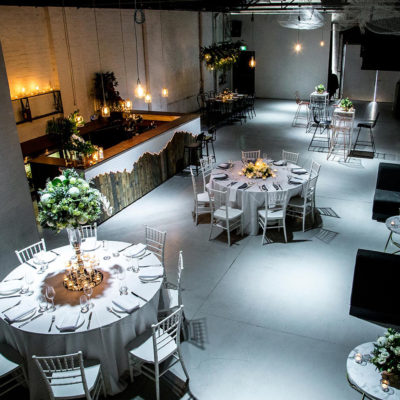Birdseye view of warehouse space with round tables