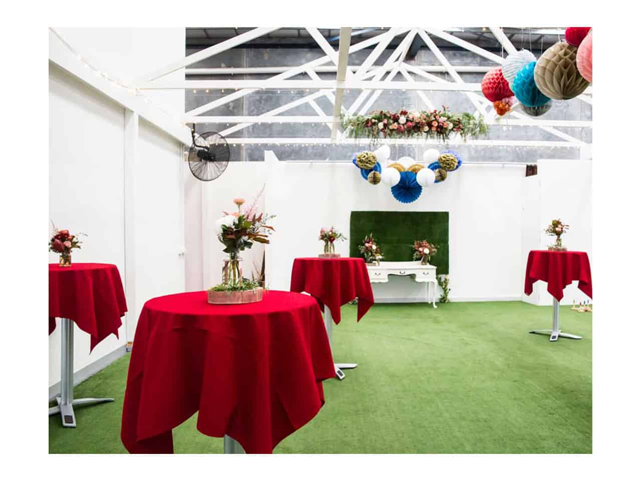 Open space function area with round red tables