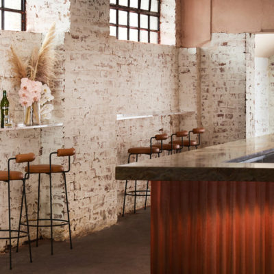 Barstools against brick white washed wall