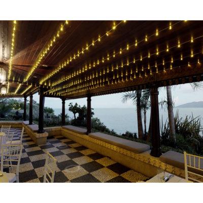 Balcony dining area at dusk overlooking sea