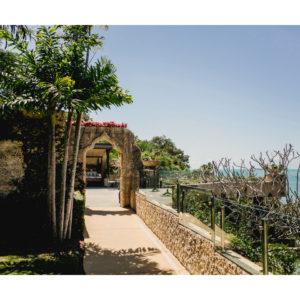 Pathway towards balcony overlooking sea